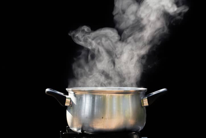 Boiling Water Steam steam over cooking pot...