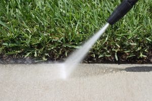 How to Clean Your Driveway or Sidewalk with a Pressure Washer